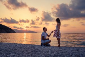 Romantic marriage proposal on the beach