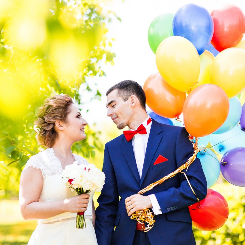 Happy bride and groom with balloons